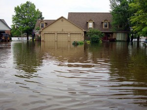 a flooded home with water surrounding it