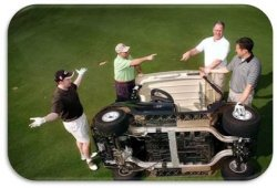 a golf cart laying on its side surrounded by people appearing to argue about the incident