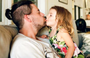 Father kissing his child