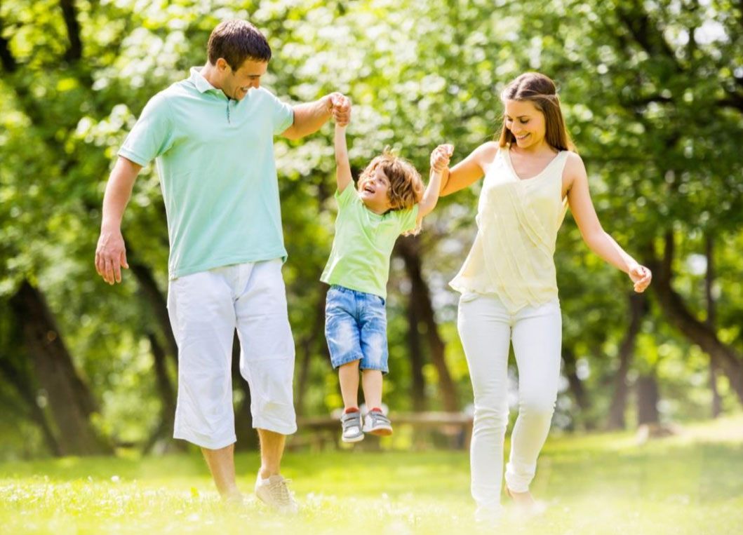 Happy family walking with child